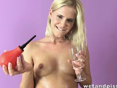 Tow-headed freak gets herself all hurtful and wet during a solo show