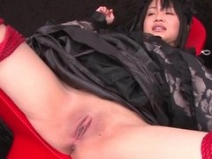 Speculum opens pussy for bound Japanese girl