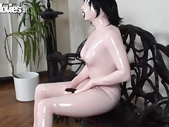 Sweetheart relative to weird latex suit plays with her marital-device